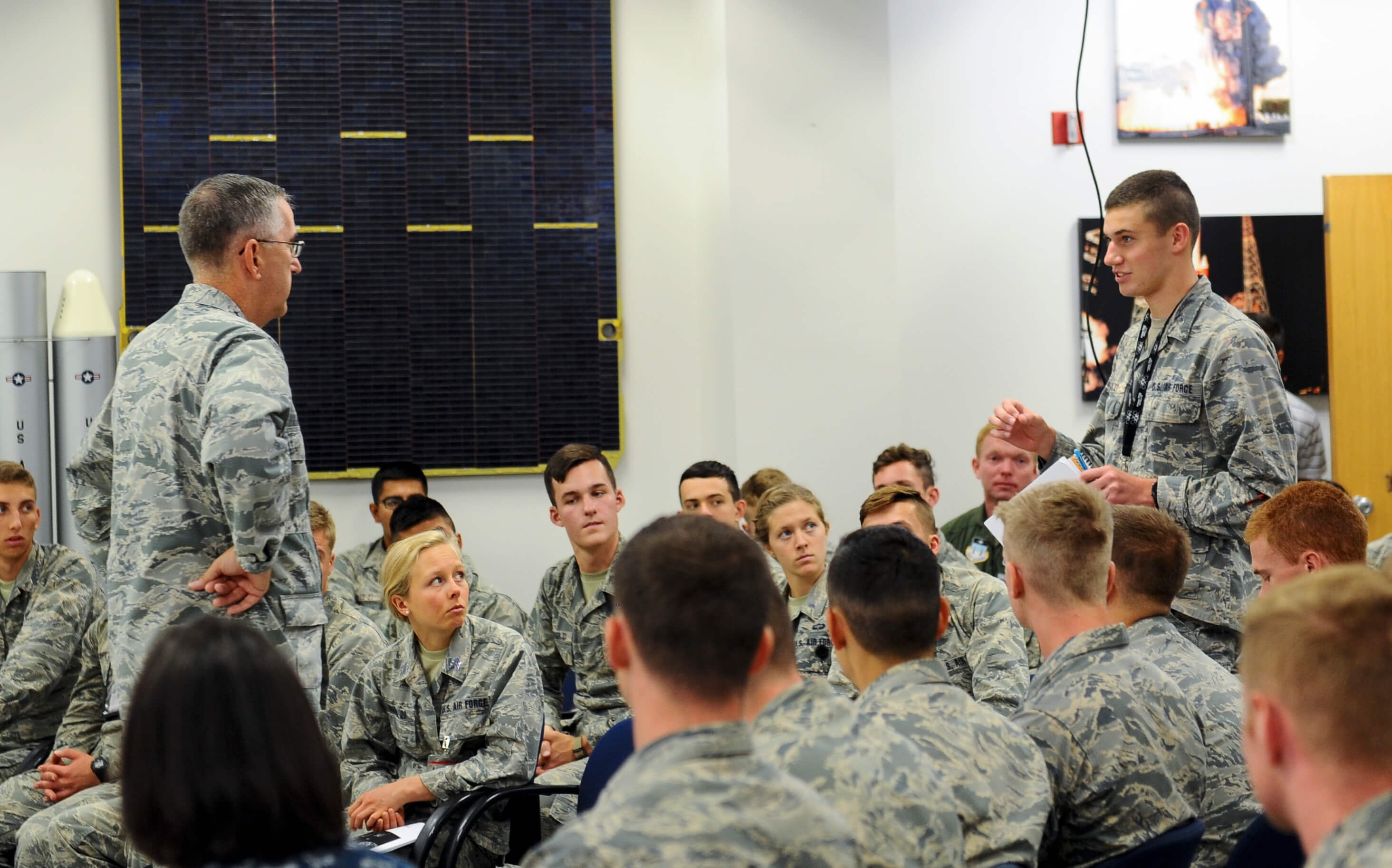 U.S. Air Force Gen. John E. Hyten, U.S. Strategic Command commander, listens to a question from a cadet during his visit to the U.S. Air Force Academy's FalconSAT engineering program at the Air Force Academy, Colo., Aug. 10, 2018. FalconSAT is the name of the Academy's small satellite engineering program where cadets get hands-on experience designing, building, testing, launching and operating satellites. (U.S. Air Force photo by Staff Sgt. Charles Rivezzo)