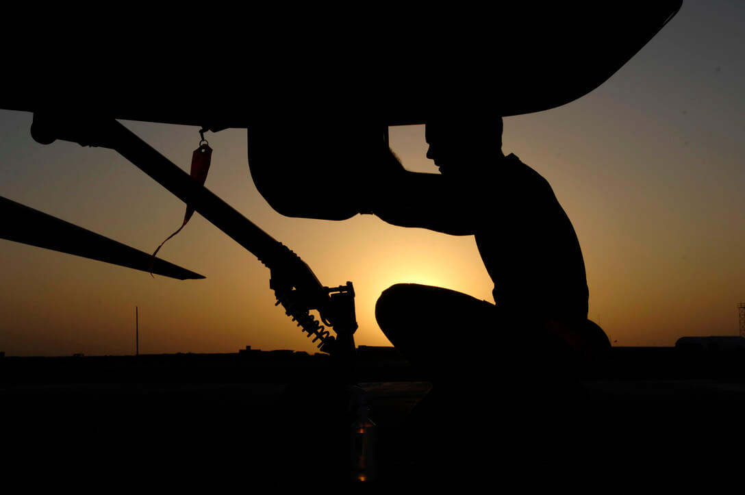 silhouette of person working on plane