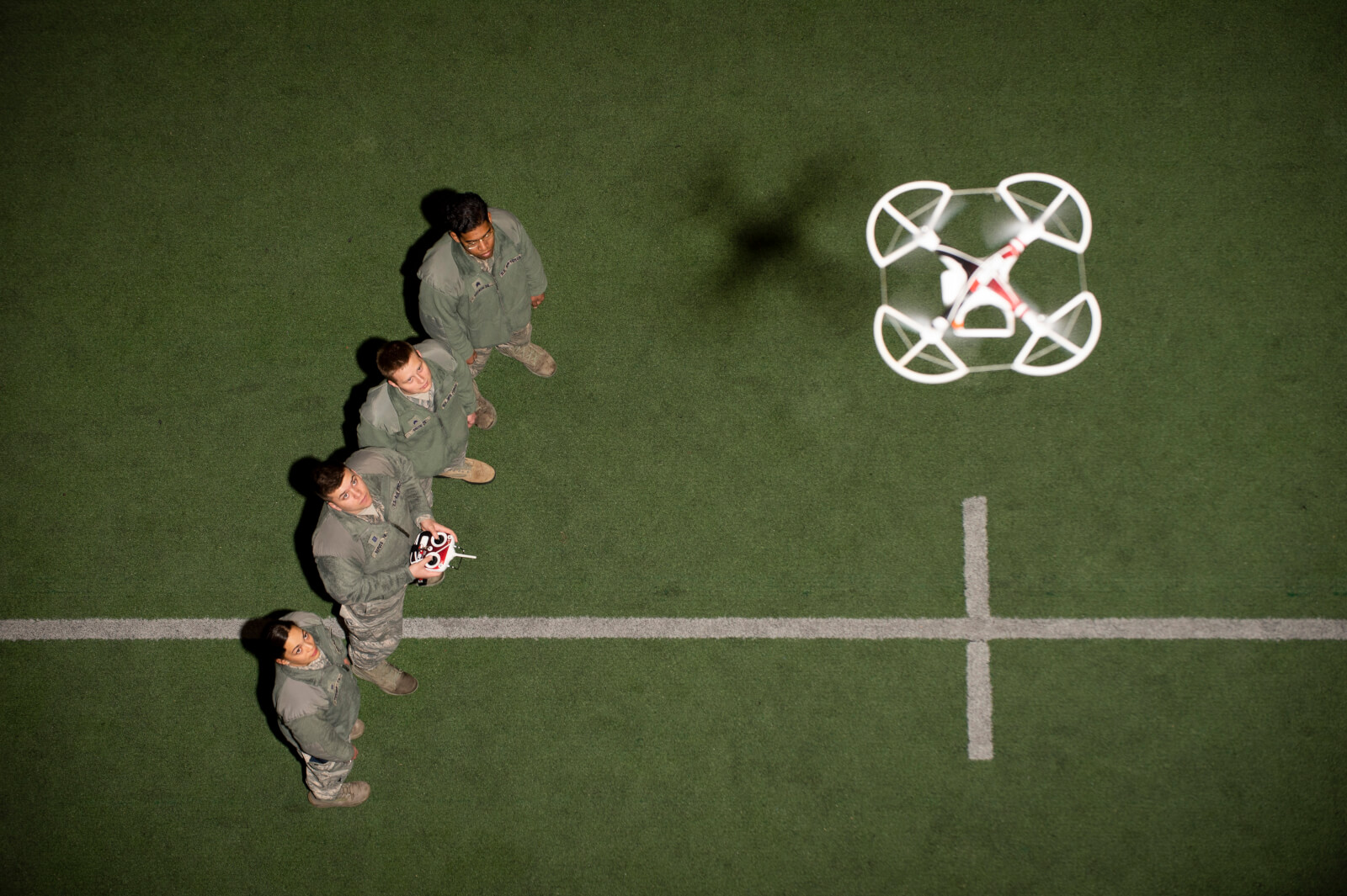 four cadets with drone flying above them