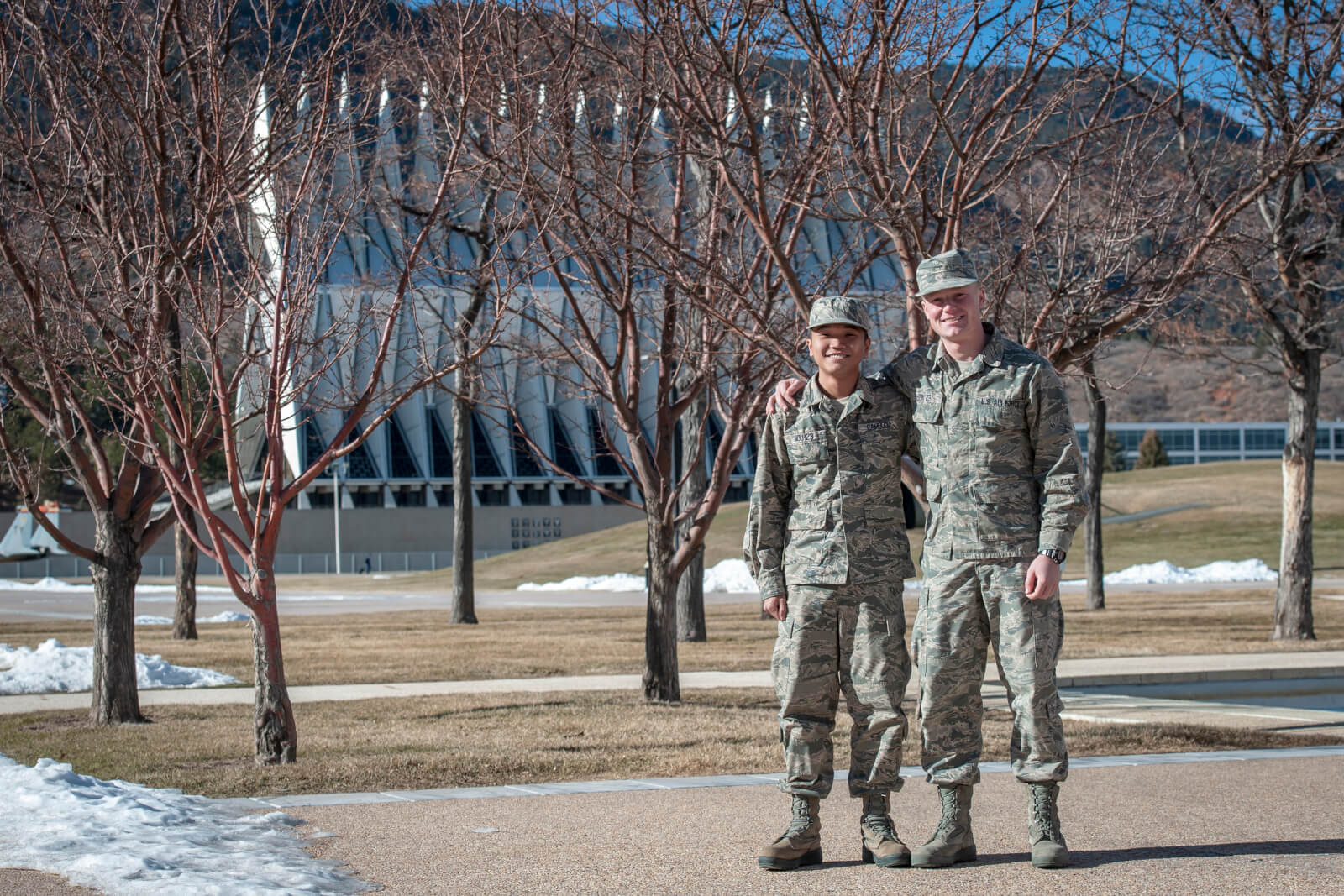 Two cadets in front of chapel
