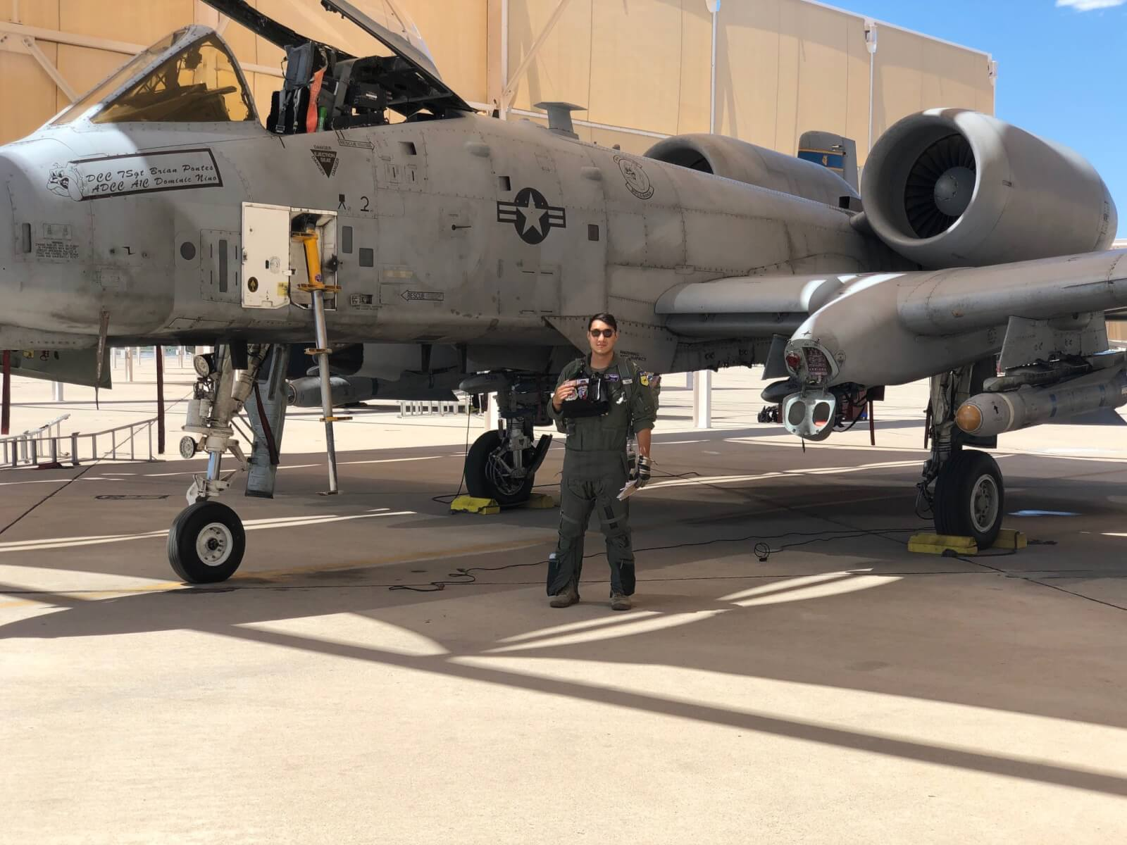 Warthog pilot next to plane