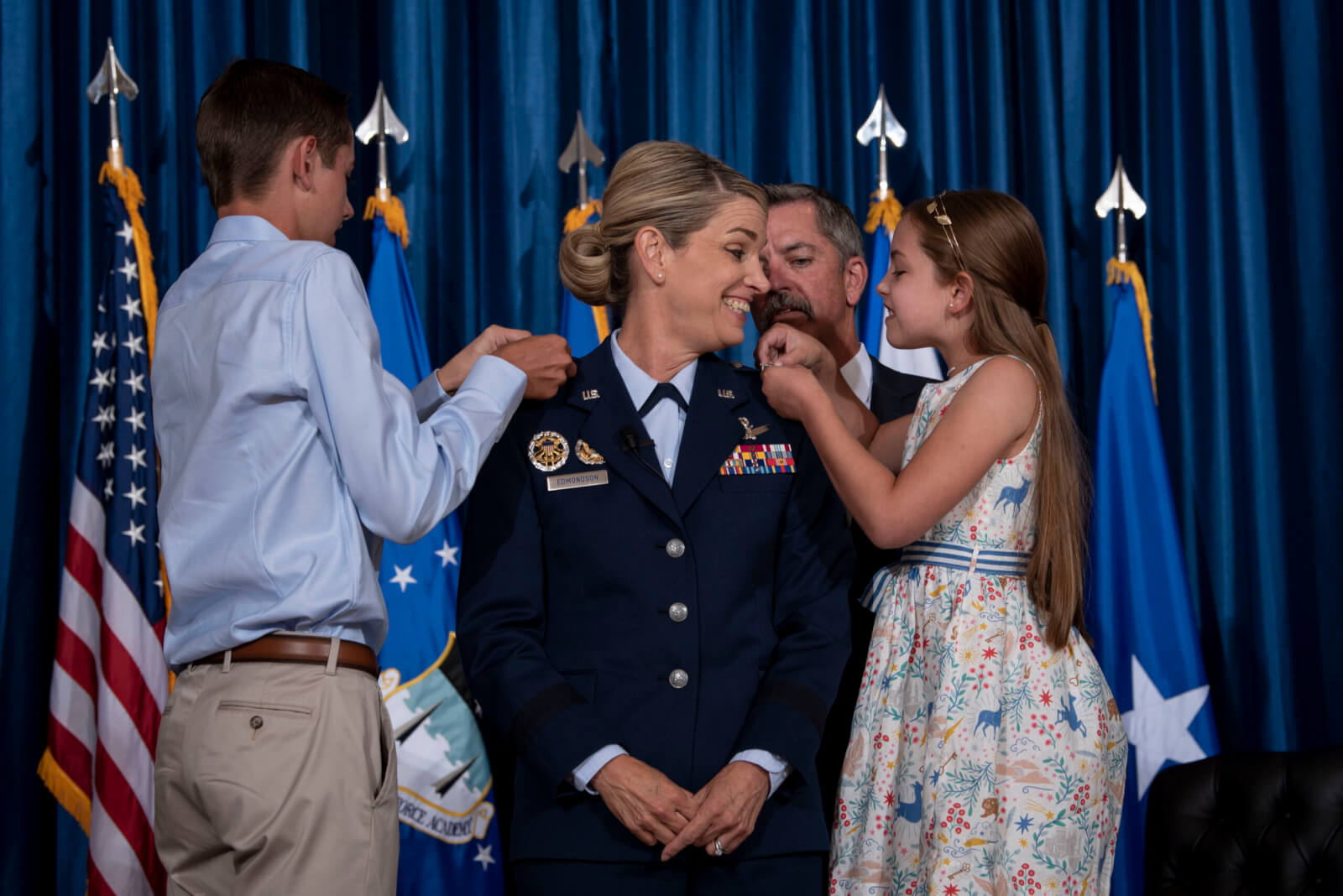 Maj. Gen. Michele Edmondson's family pins on her second star during her promotion ceremony from brigadier general to major general, Sept. 3, 2020.