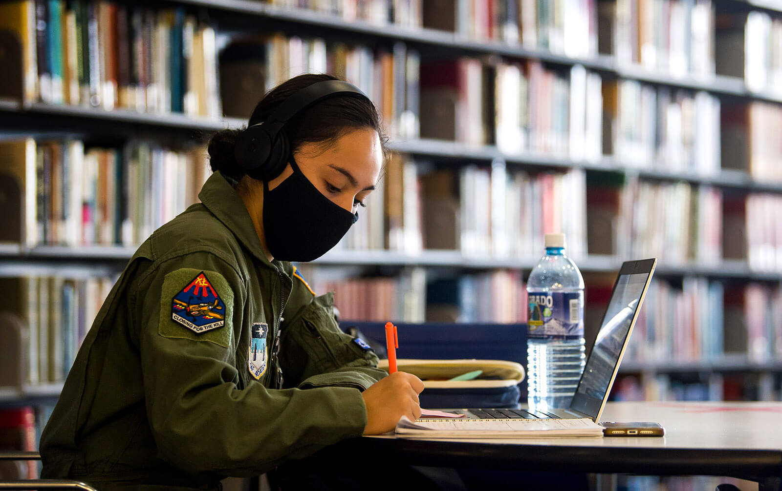 Female cadet wearing mask in library
