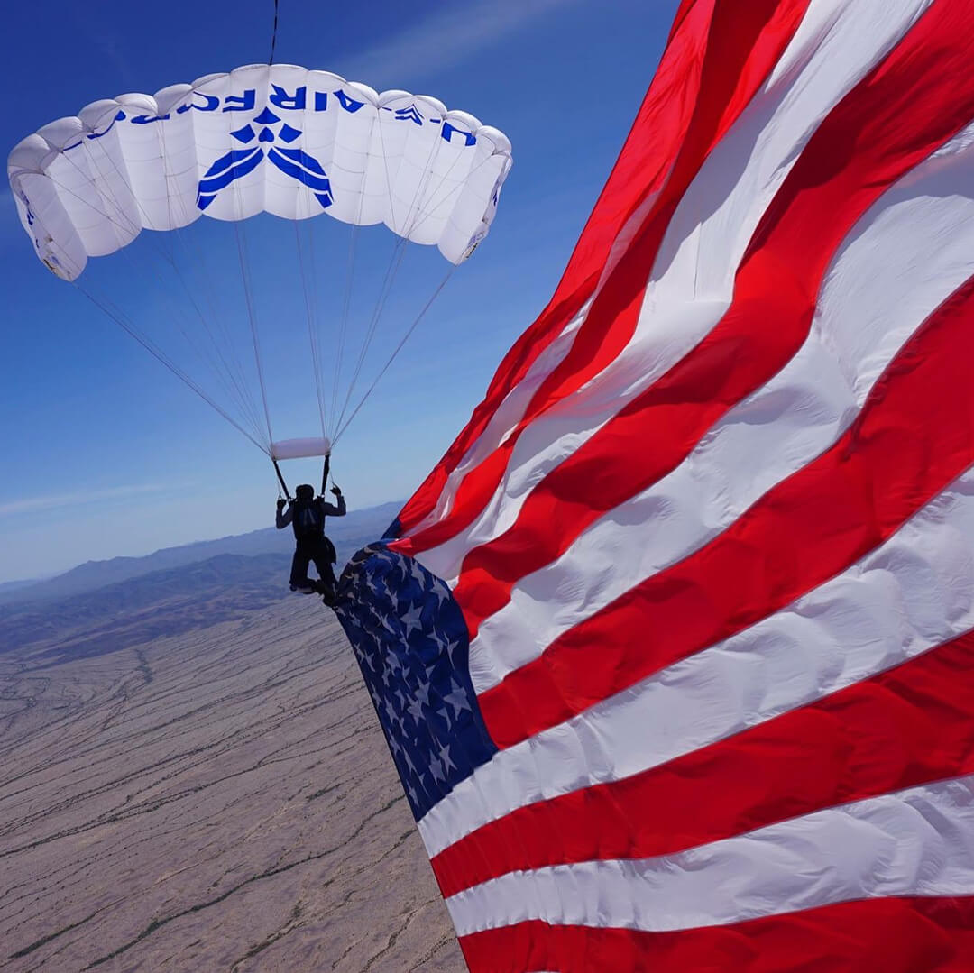 Wings of Blue member skydiving with US flag