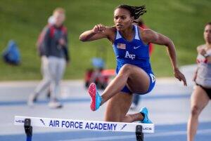 Cadet running hurdles