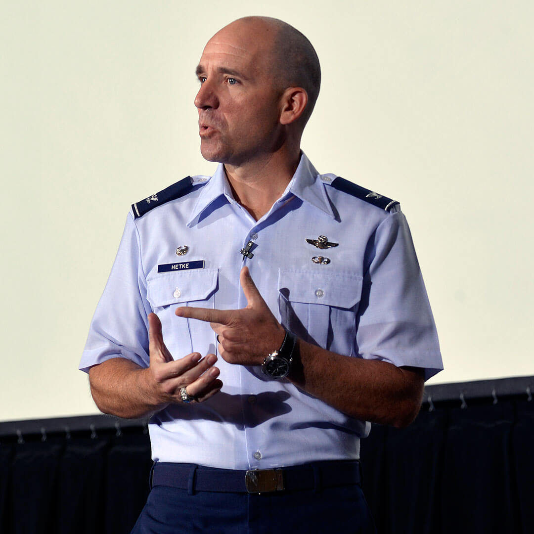image of a senior staff member giving a speech in Arnold Hall at the U.S. Air Force Academy