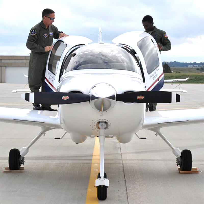 Cadets inspect an airplane on the Academy runway.
