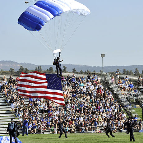 image of a parachutist landing at Stillman Field.