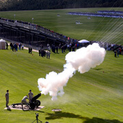 image of a canon firing during a graaduation parade.