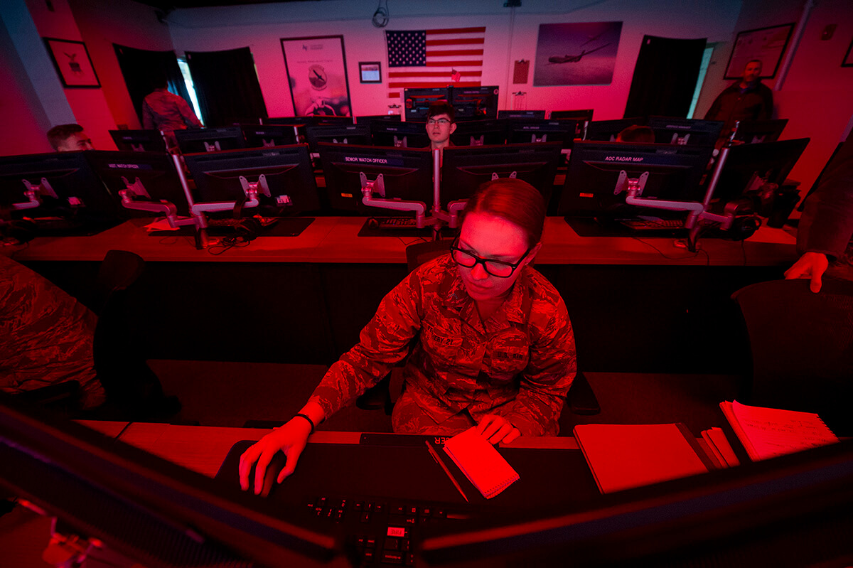 Cadets in room with red lighting