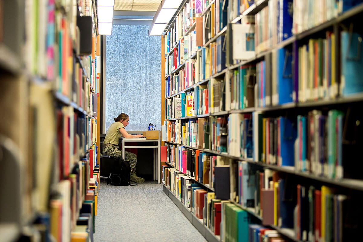 Cadet in library