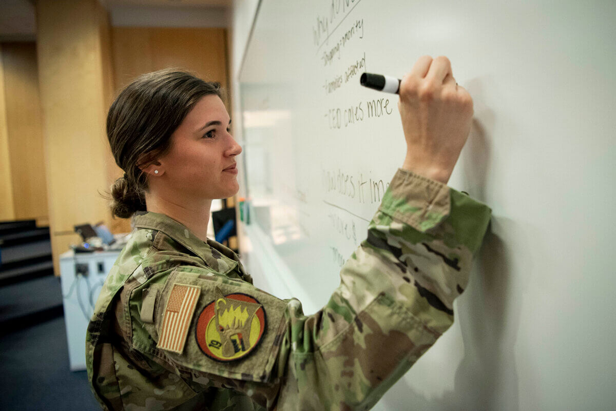 cadet writing on whiteboard