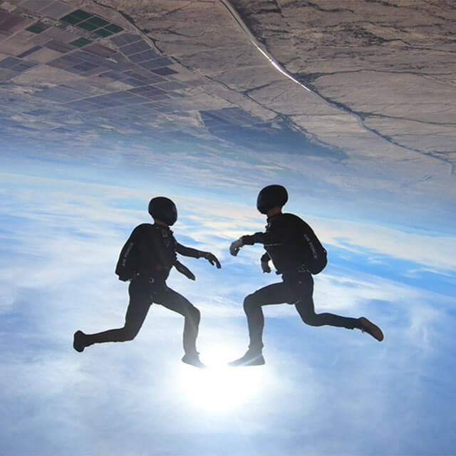 Two competition team members doing moves during skydive