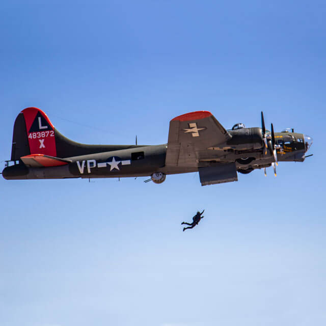 Wings of Blue member jumping out of B-17