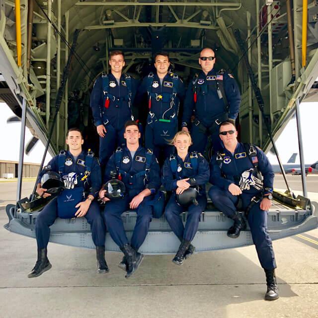 Wings of Blue members in plane tailgate