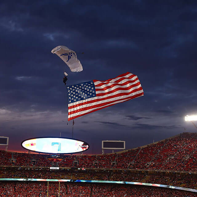 Wings of Blue member trailing flag into Arrowhead Stadium during KC Chiefs game