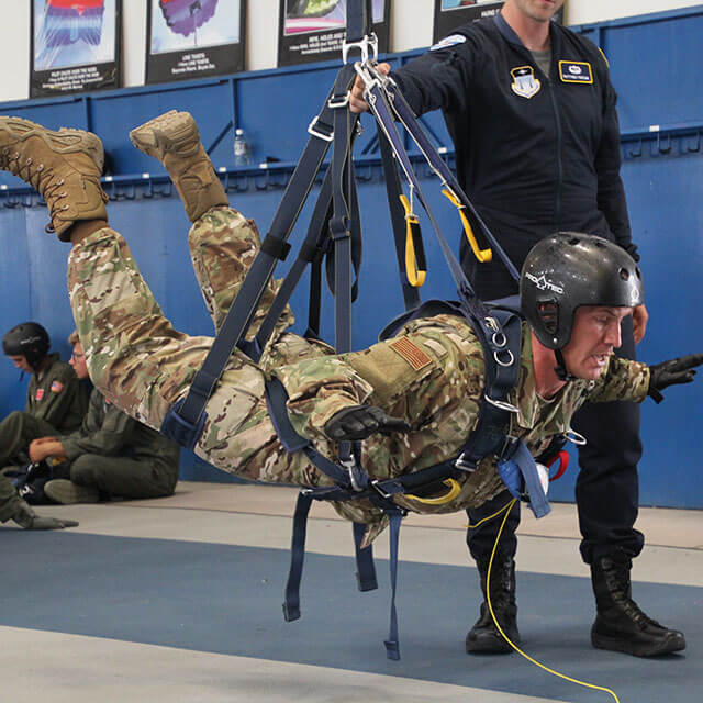 Cadet suspended in harness