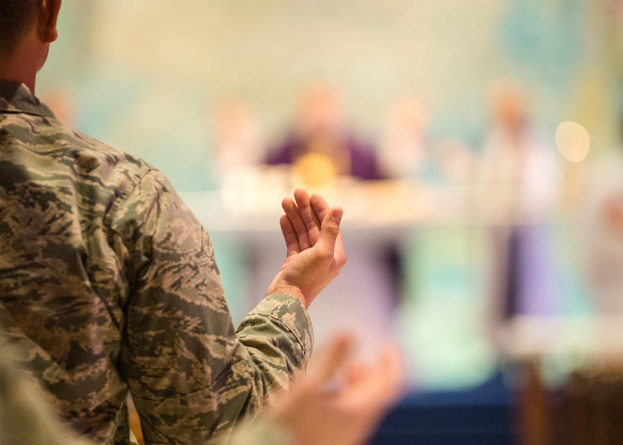 Image of cadet in prayer at the U.S. Air Force Academy.