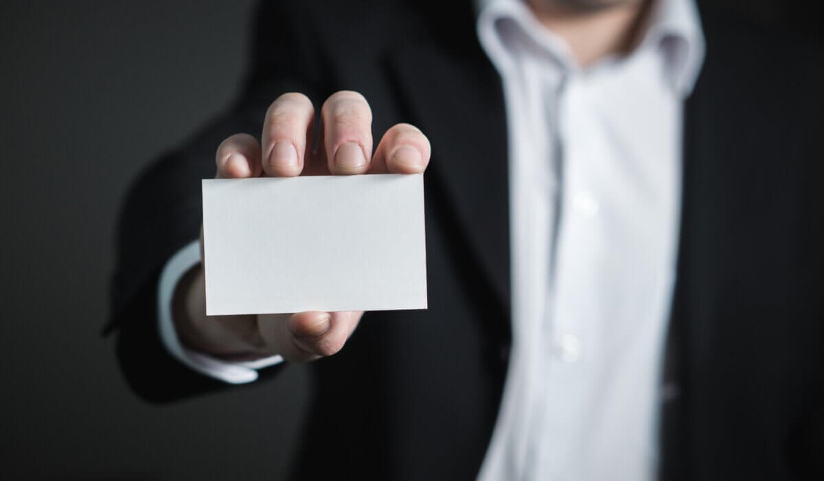 person with card in hand